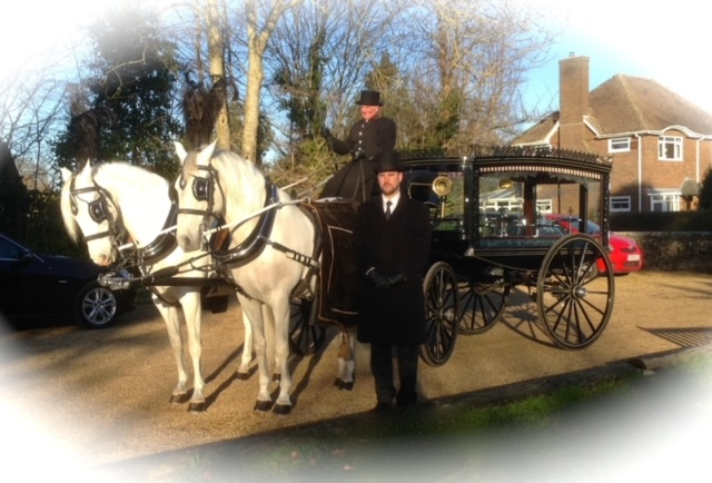 A horse drawn hearse